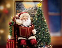 Santa Claus reading the Christmas Book near the magic tree