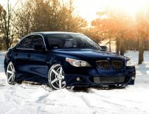 Blue BMW in the white snow - HD Winter wallpaper