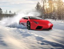 Red Lamborghini drift in the snow - White winter season