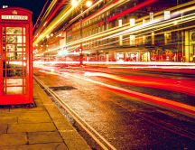 Red telephone cabine in the middle of London - Night lights