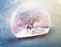 Winter season in a crystal globe - December month