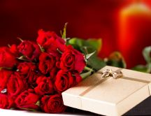 Golden gift box and a wonderful bouquet of red roses