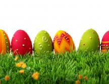 Beautiful colorful Easter eggs in the grass - Happy Holiday