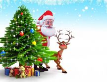 Santa Claus and little Rudolf reindeer near Christmas tree