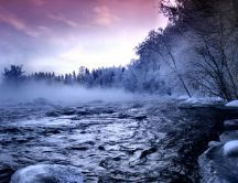 Fog over the cold mountain river in winter season