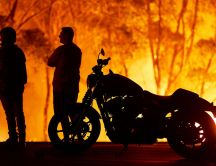 Two people and a motorcycle in Australia - Fire on continent