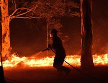 Fireman works to stop the big fire in Australia -Forest burn