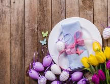 Purple Easter eggs and beautiful tulip flowers - Spring time