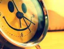 Smiley face on a happy clock - The alarm rings wake up now