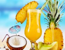 Delicious pineapple summer fresh drink in a coconut