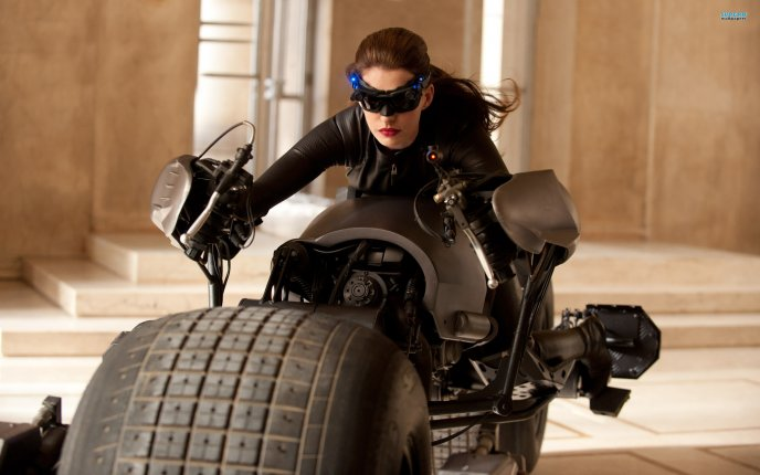 https://www.wallpapermania.eu/images/lthumbs/2012-07/3248_Catwoman-on-a-huge-dark-bike-The-dark-knight-rises-movie.jpg