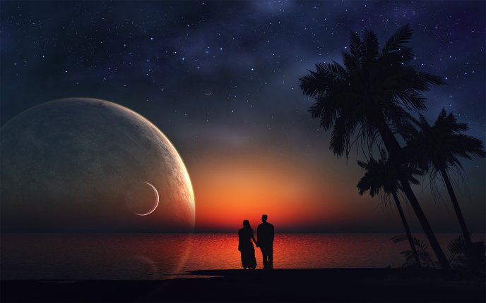 A romantic night  - love on the beach looking at the moon