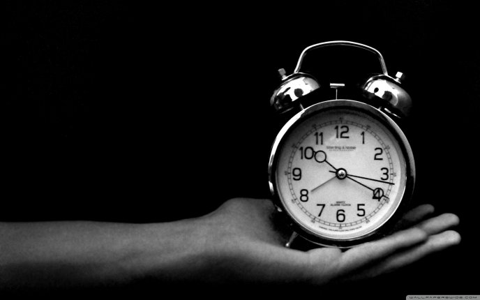 Holding an old black and white clock HD wallpaper