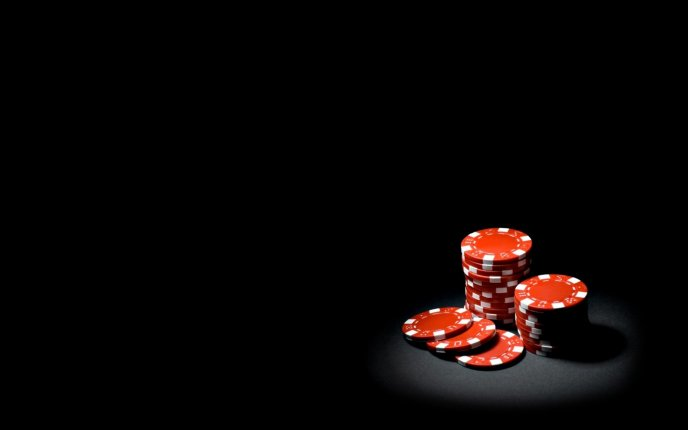 Download Wallpaper Red poker chips in the spotlight - HD wallpaper