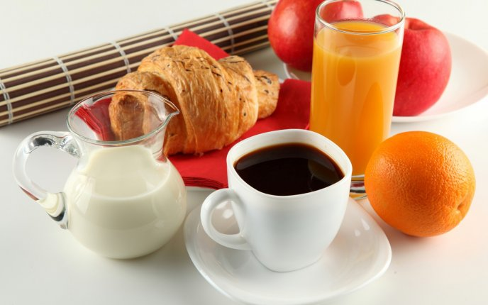 Delicious and healthy breakfast - juice, milk and coffee