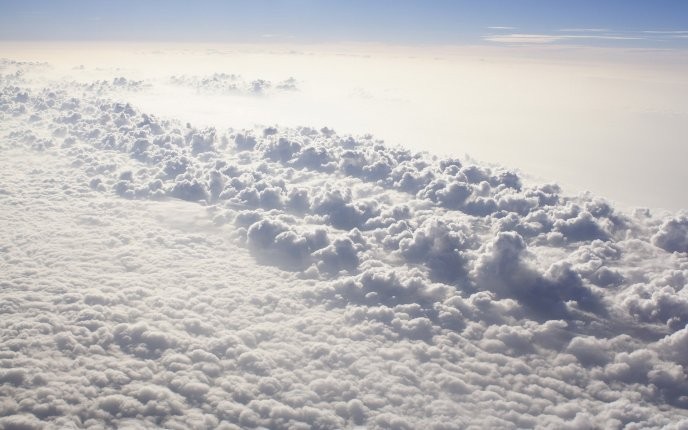 View of  a fluffy carpet of clouds