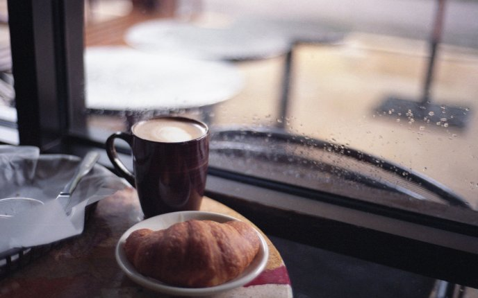 Delicious breakfast on a rainy day - coffee and croissant