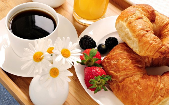 Black coffee, fruits and croissant - perfect breakfast
