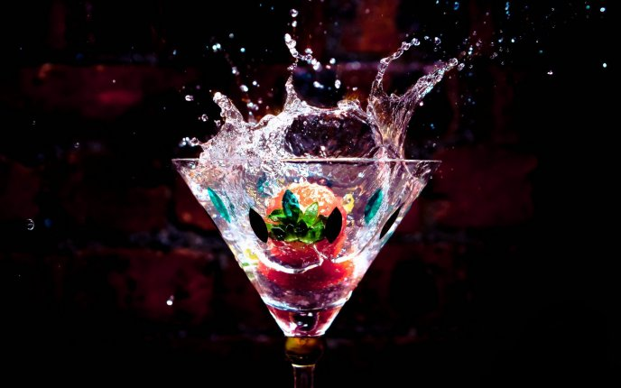 Professional photo - berries in a glass of drink