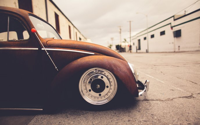 Old classic car - Volkswagen Beetle on the road