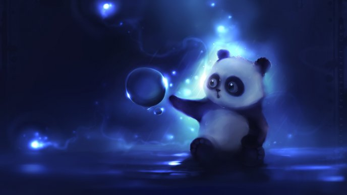 Funny little panda bear playing with a bubble of water