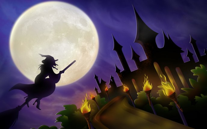 Witch on broom on Halloween night