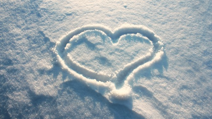 I love winter - heart drawing in the snow
