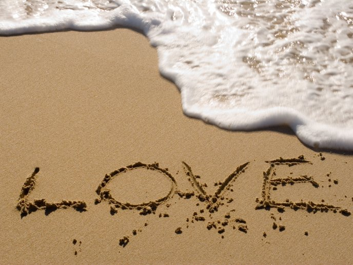 Love message on the beach - see foam