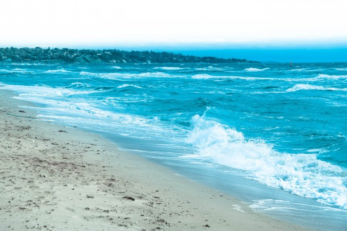 Beautiful blue color of the sea water - waves in the morning