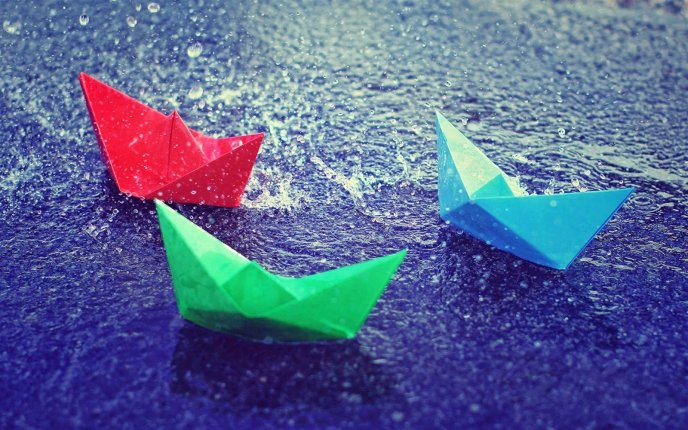 Colored paper boats on the road - Rainy day