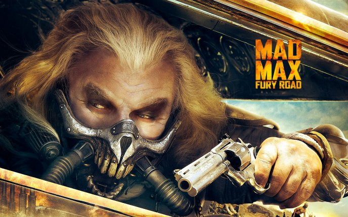 Mad Max fury road - Immortan Joe with a gun in the hand