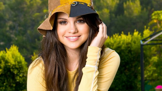 Selena Gomez with a hat on head