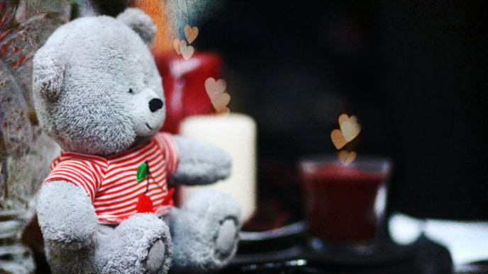 Gray Teddy bear with red and white shirt