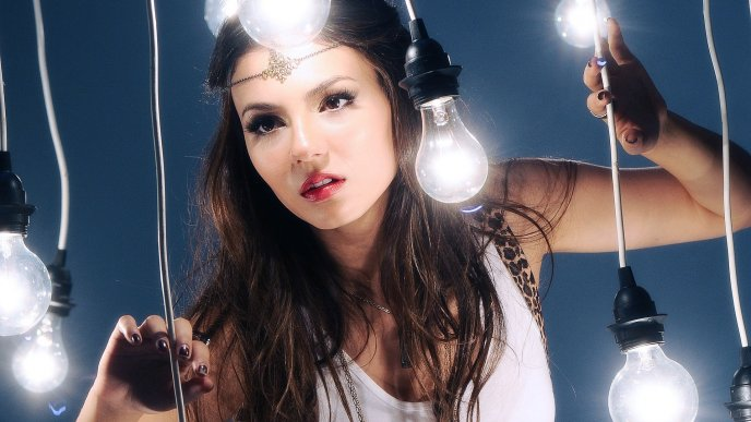 Victoria Dawn Justice poses between many bulbs