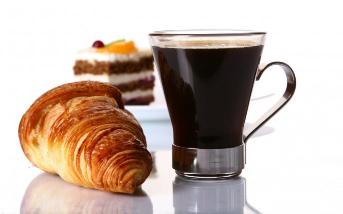 Delicious breakfast - croissant and dark coffee