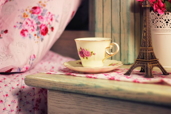Wonderful morning in Paris with a cup of tea near your bed