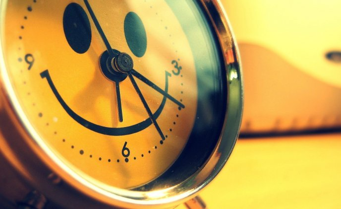Happy smiley face on a clock - Good morning