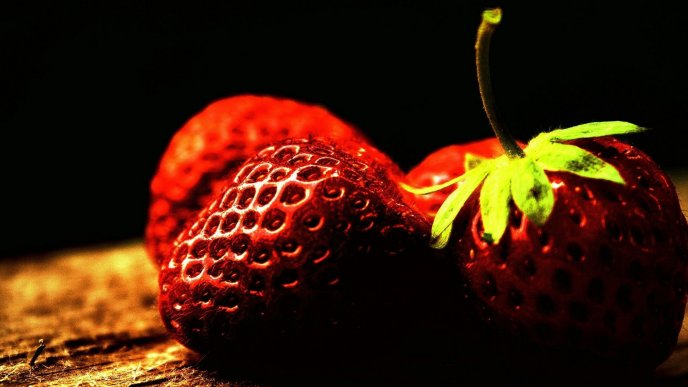 Bulb light over the strawberries - Delicious fruits
