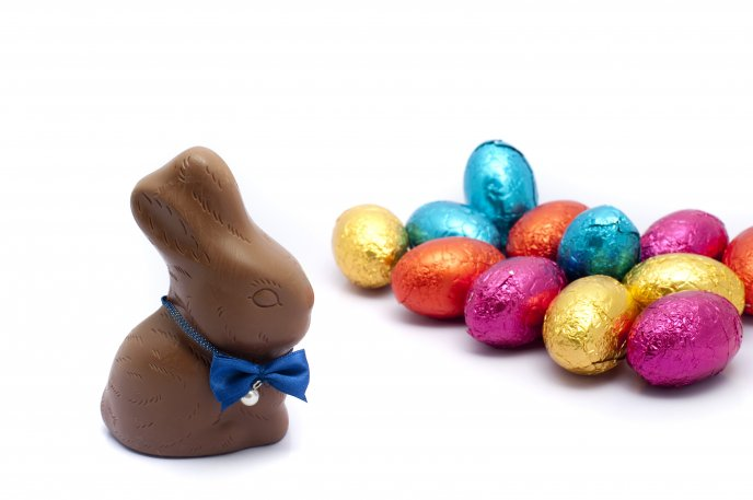 Chocolate Easter rabbit and eggs - Happy Spring Holiday