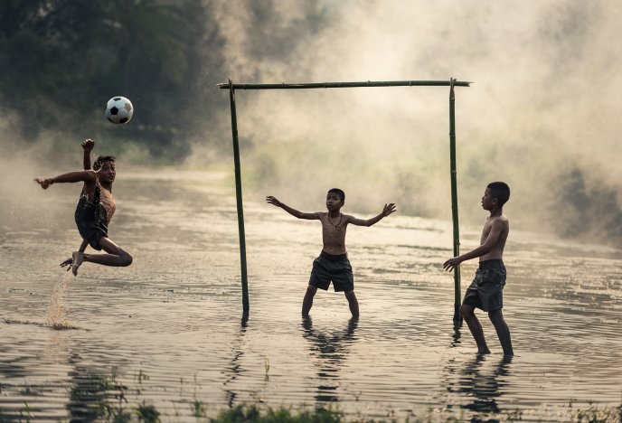 Playing football in the water - Jump action goal score point