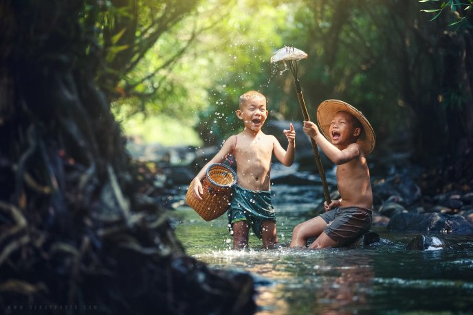 Childhood happiness - Two boys at fishing in the river