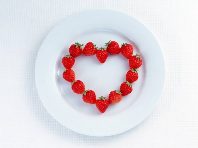 Sweet strawberry heart in a white plate - Valentines day
