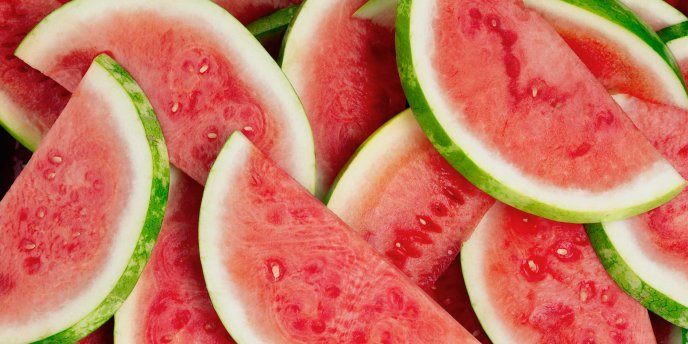 Fresh and cold slices of watermelon fruit - Hot summer day