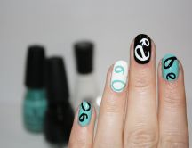 Painted nails black white and turquoise