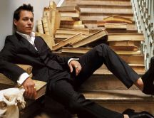 Legendary Johnny Depp sitting on stairs