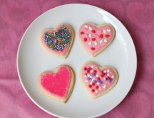 Four pink heart-shaped cookies
