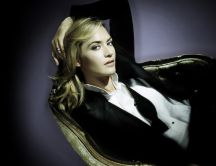 Kate Winslet posing in an armchair