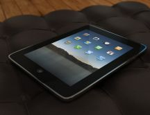 Ipad on a black sofa HD wallpaper