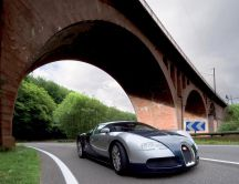 Beautiful car - Bugatti Veyron passing under a bridge