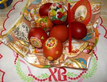 Red painted eggs on table